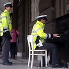 Policeman street piano