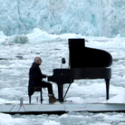 Einaudi plays piano on an iceberg in Arctic